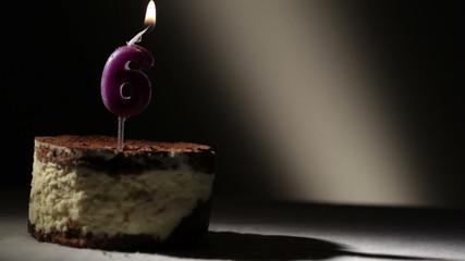 Candle six in tiramisu cake.