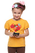 Little girl in a yellow shirt with smartphone