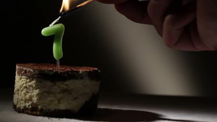 Candle seven in tiramisu cake.