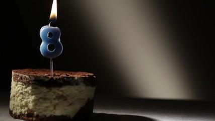 Candle eight in tiramisu cake.