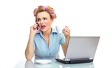 unhappy business woman on phone with laptop