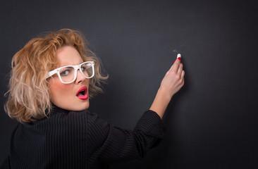 Angry professor woman in front of blackboard