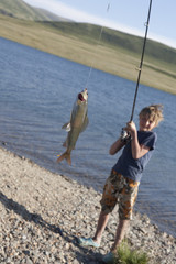 The boy with a spinning catch grayling