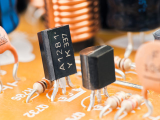 several transistors mounted on board with other components