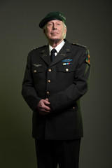 Military general in uniform wearing beret. Studio portrait.