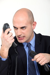 Furious man on the phone