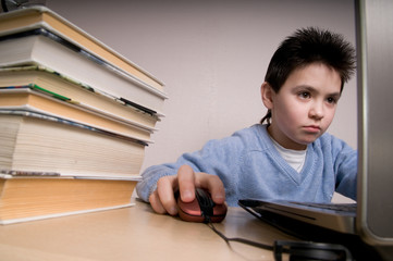The boy with laptop and the books