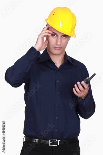 Engineer scratching his head