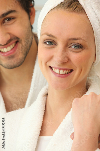 Couple in bath robes getting ready