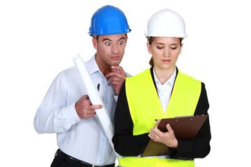Amazed architect reading an inspector's report