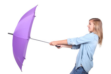 Blond woman holding umbrella