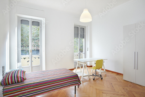 Bedroom in small modern apartment