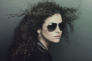 curly hair woman with sunglasses