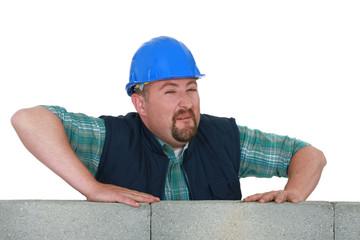 expressive mason behind brick wall