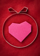 Hand made paper heart on red  paper