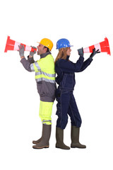 Labourers shouting in traffic cones