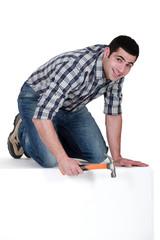 carpenter using hammer isolated on white