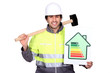 Man stood with sledge hammer and energy rating poster
