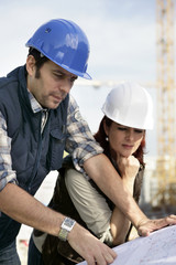 Foreman and female colleague on site