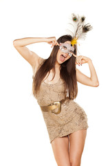 Sexy brunette posing with a mask on white background