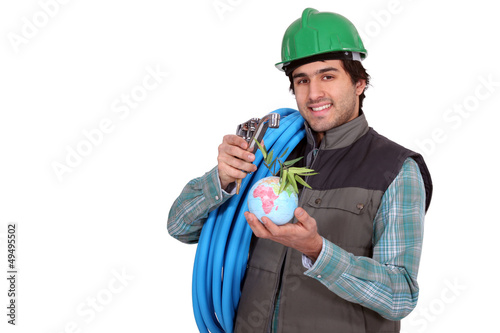 a plumber with a little globe in the hand