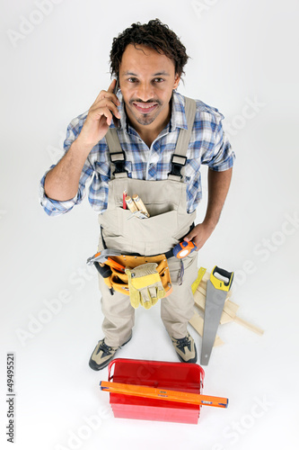 Carpenter using a telephone