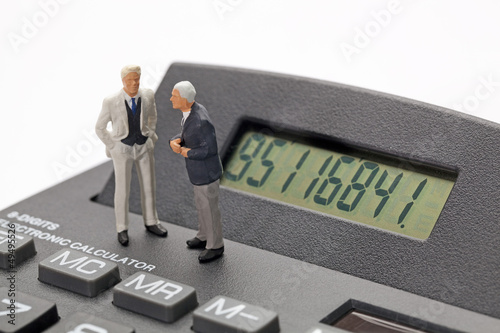 financial discussion around a calculator