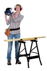 A woman operating a circular saw