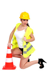 portrait of sexy female builder with construction cone