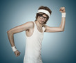 Funny retro nerd flexing his muscle over blue background