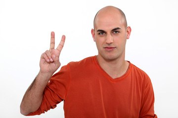 Man giving the peace sign