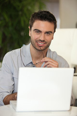 Man sat with laptop computer
