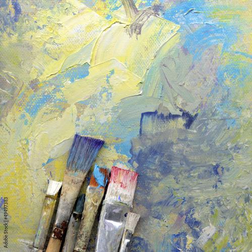 canvas print picture pinsel mit farbe auf gemaltem hintergrund