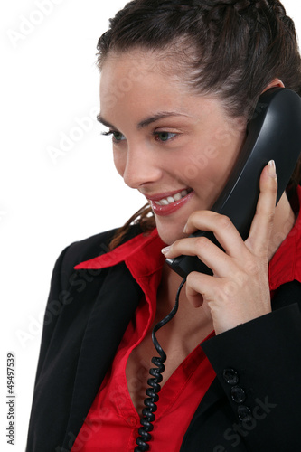 Brunette receiving good new over the phone