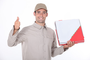a delivery man holding a packet and doing thumbs up