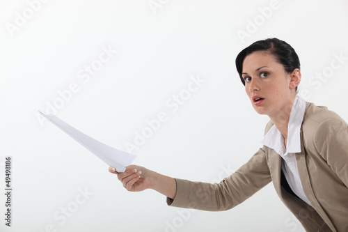 Woman shocked at a piece of paper