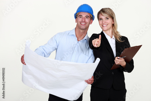 female architect and foreman holding plans