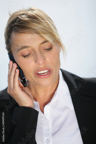 Businesswoman outside on the phone