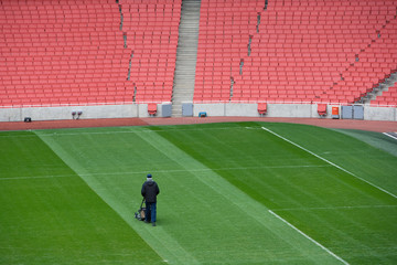 Groundsman at football stadium