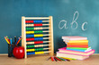 Toy abacus, books and pencils