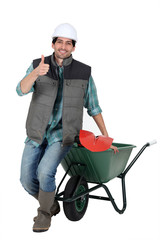 bricklayer with wheelbarrow and trowel thumb up
