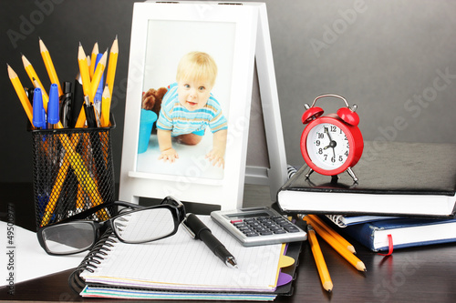White photo frame on office desk on grey background