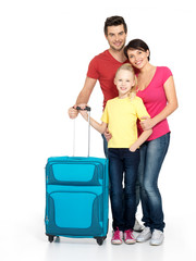 Happy family with  suitcase  at studio