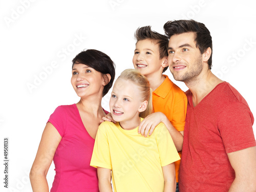 Happy family with two children looking side