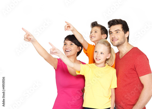 family with two children pointing finger up