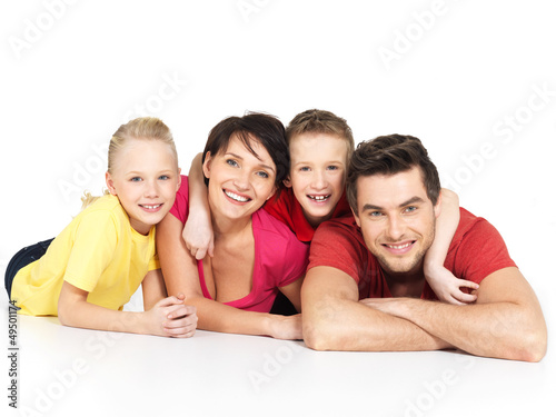 happy family with two children lying on white floor