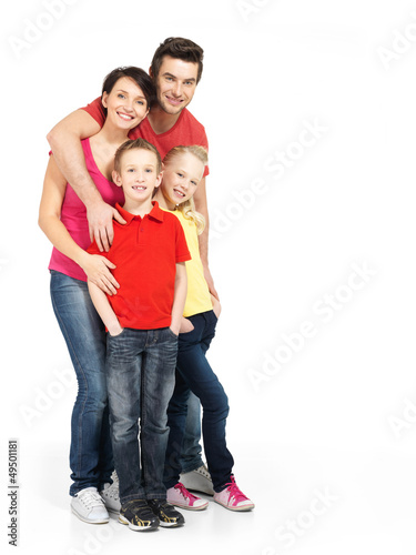 Full portrait of the happy young family with two children