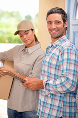 Man collecting package at home