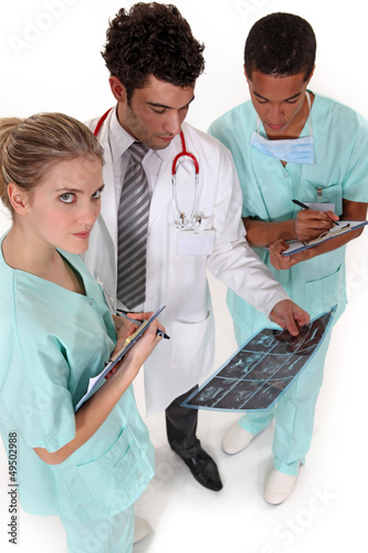 medical professionals discussing results of a patient's x-ray
