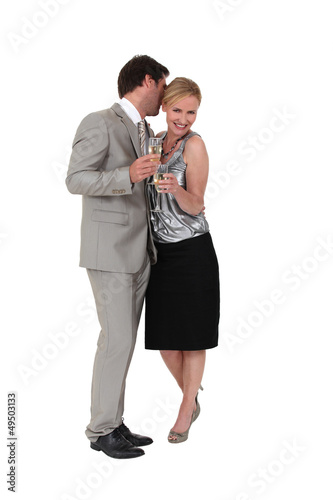 Couple flirting and drinking champagne